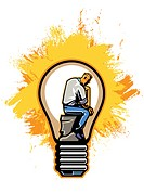 Businessman inside light bulb