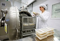 Researcher setting prepared food in autoclave to pasteurize, pilot plant, AZTI-Tecnalia, Technology Centre for Marine and Food Research, Derio, Biscay...