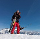 Skiers playing piggyback ride
