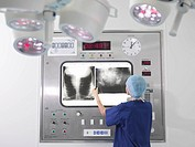 Nurse with x_rays in operating theatre
