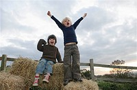 Young boys on hay bales