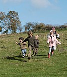 Children running in countryside