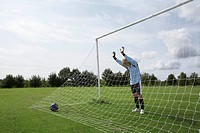 Goalkeeper standing next to net