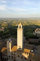 San Gimignano Tuscany Italy View across the Palazzo Vecchio del Podesta and the Torre Rognosa towards surrounding countryside