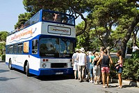 Tourists queuing to board a Malta sightseeing tour bus, Mdina, Malta