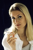 Woman holding cigarette, portrait
