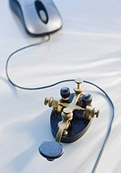 Antique telegraph key and computer mouse