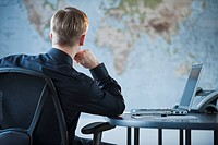 Businessman looking at world map