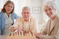 Senior adults playing chess