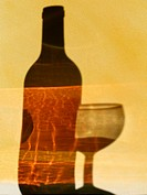 Shadow of a bottle and glass of red wine