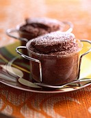 Bitter chocolate souffl&#233;e with icing sugar