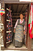 Tibetan woman standing in the doorway of her store  Marpha, Nepal