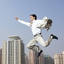 Businessman flying with his arms outstretched