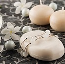 Close_up of a bar of soap with pearls and flower