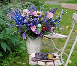 Spray of flowers on a garden chair