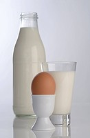 Natural milk in a bottle and biological egg in an eggcup (thumbnail)