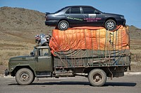 Truck hauls an automobile won in the Mongolian lottery from Ulaan Baatar to far western Mongolia on top of a truck The journey between Ulaan Baatar an...