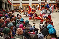 Masked monks dancing for a crowd of spectators Lama Yuru, Ladakh, India