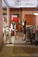 Portrait of young fashionable businesswomen in boardroom