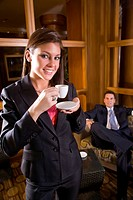 Close up portrait of business colleagues in hotel lobby