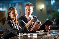 Close up portrait of young traveling businesspeople in modern hotel