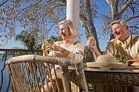 Portrait of senior couple relaxing on veranda of house, close_up