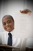 Boy with exam paper