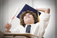 Graduating boy looking up