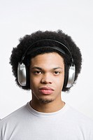 A young man listening to music (thumbnail)
