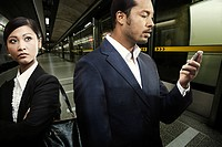 Businesspeople waiting on a subway platform
