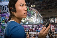 A young man wearing a bluetooth headset