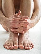 Hands and feet of man