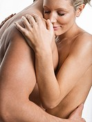 Nude couple hugging