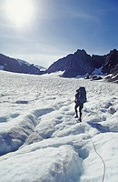 Climber crossing blue glacier mount olympus