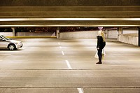 Woman in alone in parking lot