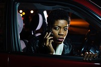 Woman on cellphone in car
