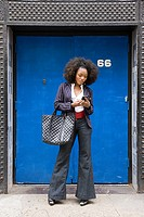 Stylish woman with cellphone
