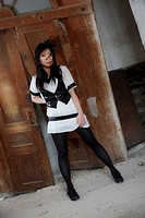 beautiful asian girl posing in black and white dress