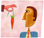 A hand dangling a carrot in front of a business mans face (thumbnail)