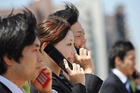 Japanese People Talking On Cell Phones