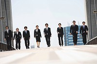 Young Japanese Businesspeople Walking