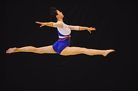 Gymnast performing her floor exercise