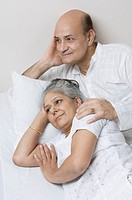 Couple lying on the bed and day dreaming