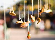 Close_up of hanging wooden figurines, New Delhi, India