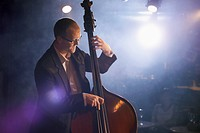 Double bass player on stage portrait (thumbnail)