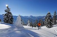 Backcountry skier in snow_covered mountain scene moving up, Feuerstaetter Kopf, valley of Balderschwang, Balderschwang, Allgaeu range, Allgaeu, Swabia...