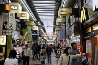 People at a canopied shopping arcade, Tokyo, Japan