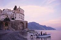 Fishermen on the beach in the evening, Atrani, Campania, Italy
