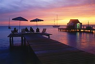 People watching a romantic sunset from wooden jetty, Divi Flamingo Beach Resort, Bonaire, ABC Islands, Netherlands Antilles, Antilles, Carribean