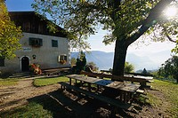 Snooze after dinner under the mountain sun, Tavern Schmiedlhof near Grissian South Tyrol, Italy